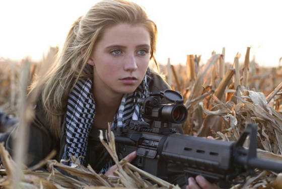 aryan girl with gun
